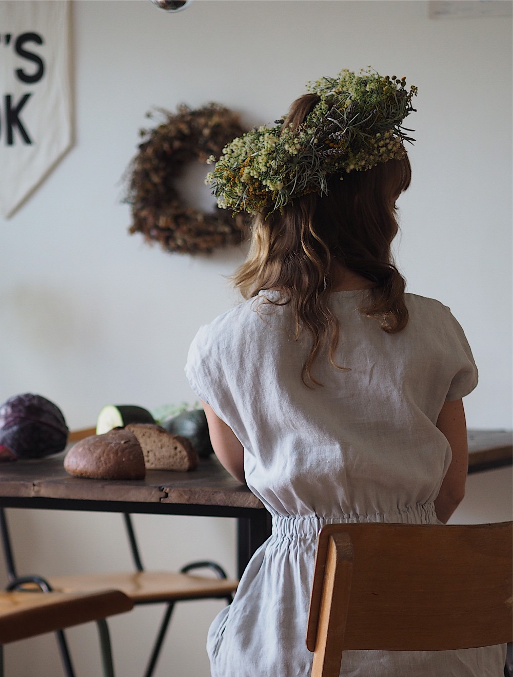 sitting_woman_desk_diy_wreath_wildflowers_evafedeveka_photography